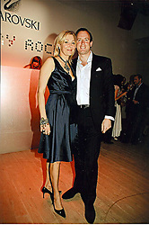 NADJA SWAROVSKI and her husband RUPERT ADAMS at the Swarovski 'Runwy Rocks' held at the Phillips de Pury Gallery, Howick Place, London on 10th June 2008.<br />