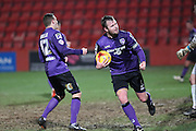 Morecambes skipper Mark Hughes celebrates the equaliser during the Sky Bet League 2 match between Cheltenham Town and Morecambe at Whaddon Road, Cheltenham, England on 16 January 2015. Photo by Shane Healey.
