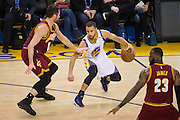 Golden State Warriors guard Stephen Curry (30) handles the ball against the Cleveland Cavaliers at Oracle Arena in Oakland, Calif., on January 16, 2017. (Stan Olszewski/Special to S.F. Examiner)