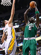 March 28, 2011; Indianapolis, IN, USA; Boston Celtics power forward Kevin Garnett (5) shoots the ball against Indiana Pacers forward Josh McRoberts (32) at Conseco Fieldhouse. Indiana defeated Boston 107-100. Mandatory credit: Michael Hickey-US PRESSWIRE