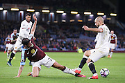 Burnley midfielder George Boyd (21)  is caught on the ankle by Watford midfielder Nordin Amrabat (7)  during the Premier League match between Burnley and Watford at Turf Moor, Burnley, England on 26 September 2016. Photo by Simon Davies.