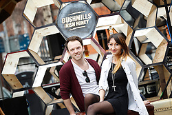 Repro Free Dublin, 5th April 2013:  To celebrate the launch of Bushmills Irish Honey, the latest addition to the Bushmills collection of premium blends and single malts, Bushmills commissioned some good friends who are artisans to make the launch memorable by handcrafting a 14 square foot Honey Hive. 2500 screws, 250 hours, 200 hexes and 10 whiskey casks later, the handcrafted wooden hive played host to a surprise live gig in Temple Bar Square, Dublin from acclaimed Northern Irish artist Rams' Pocket Radio, AKA Peter McCauley and Fiona O'Kane from Runaway Go. The celebration will continue later that evening with a launch event gig in Whelan's where Rams' Pocket Radio will headline along with other indie music artists, Runaway Go and Verse Chorus Verse. For more information about Bushmills Irish Honey and to find cocktail recipes, visit the website: www.bushmills.com or Facebook: facebook.com/bushmills1608Enjoy BUSHMILLS Sensibly Visit drinkaware.ie The BUSHMILLS word, the Pot Still device and other associated logos are trade marks. © The Old Bushmills Distillery Co. Limited 2013. Picture Andres Poveda