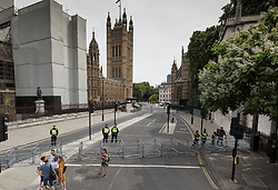 © Licensed to London News Pictures. 23/06/2018. London, UK. Police close off the road outside Parliament to keep The People's Vote March for a second EU referendum and an opposing demonstration apart. Photo credit: Peter Macdiarmid/LNP