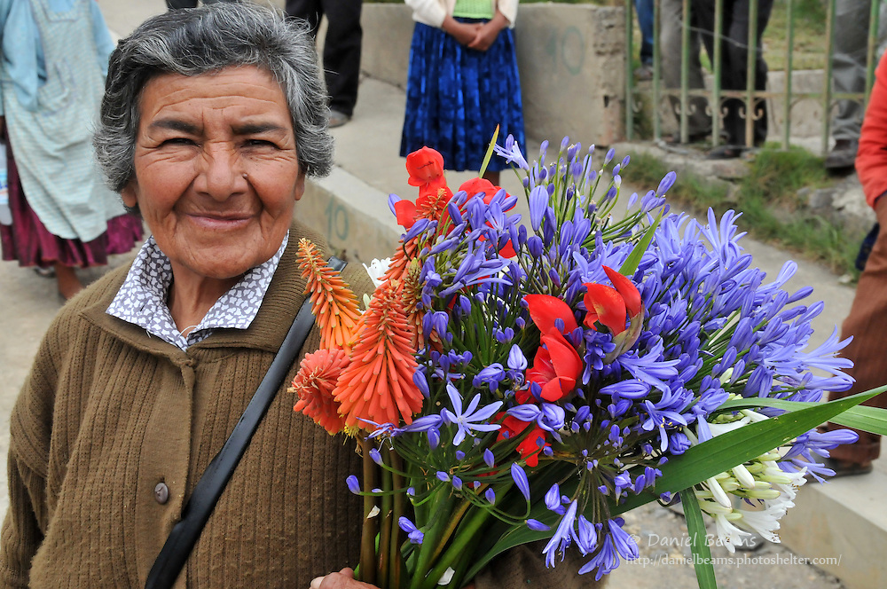 Woman with flowers in Quiabaya, Bolivia (near Sorata)