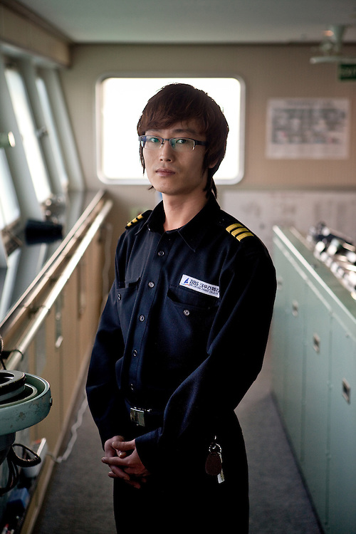"""Assistance captain on the captains bridge of the """"Eastern Dream"""" ferry connecting Donghae in South Korea with Vladivostok in Russia."""