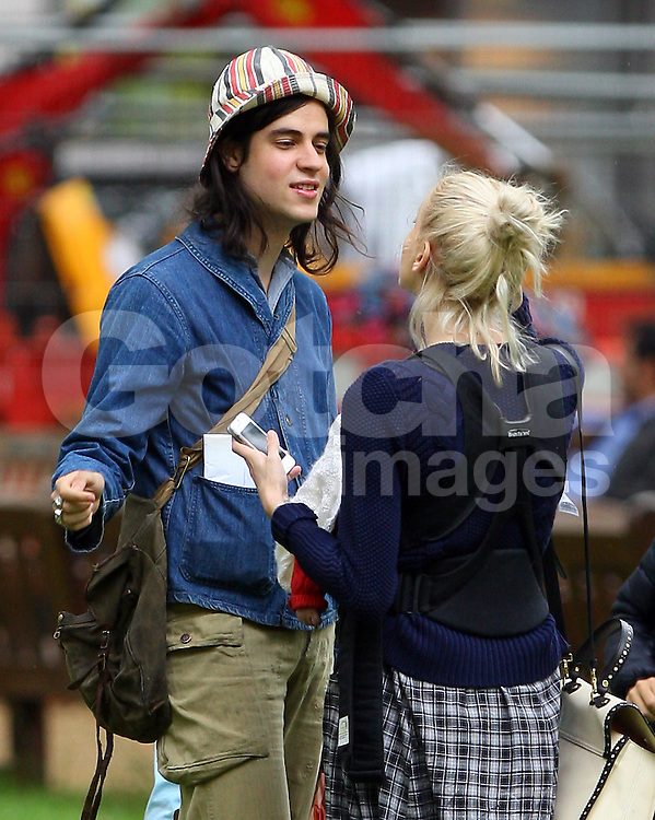 Peaches Geldof, fianc&eacute; Thomas Cohen and son Astala visit The Portland Hospital for Women and Children outpatients in Great Porland Street. As the pair arrived at the hospital, Peaches was kissing and holding Astala, as for Thomas he looked to have his hands full with a shoulder bag, Peaches handbag, bottle of milk, baby carrier and holding onto their beloved dog Parpy. Peaches wearing a blue cardigan, black top and a long checked skirt left the hospital about half an hour later and got a taxi to Berkeley Square for their dog Parpy to have a quick run around, before heading home. London, UK. 03/07/2012 <br />