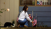 Victoria Lukenovich tends to her small memorial outside of their apartment in Troutdale, her husband serving in Iraq and she keeping the home fires burning.