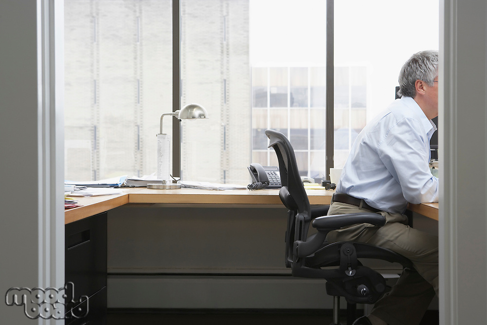 Business man working at desk in office