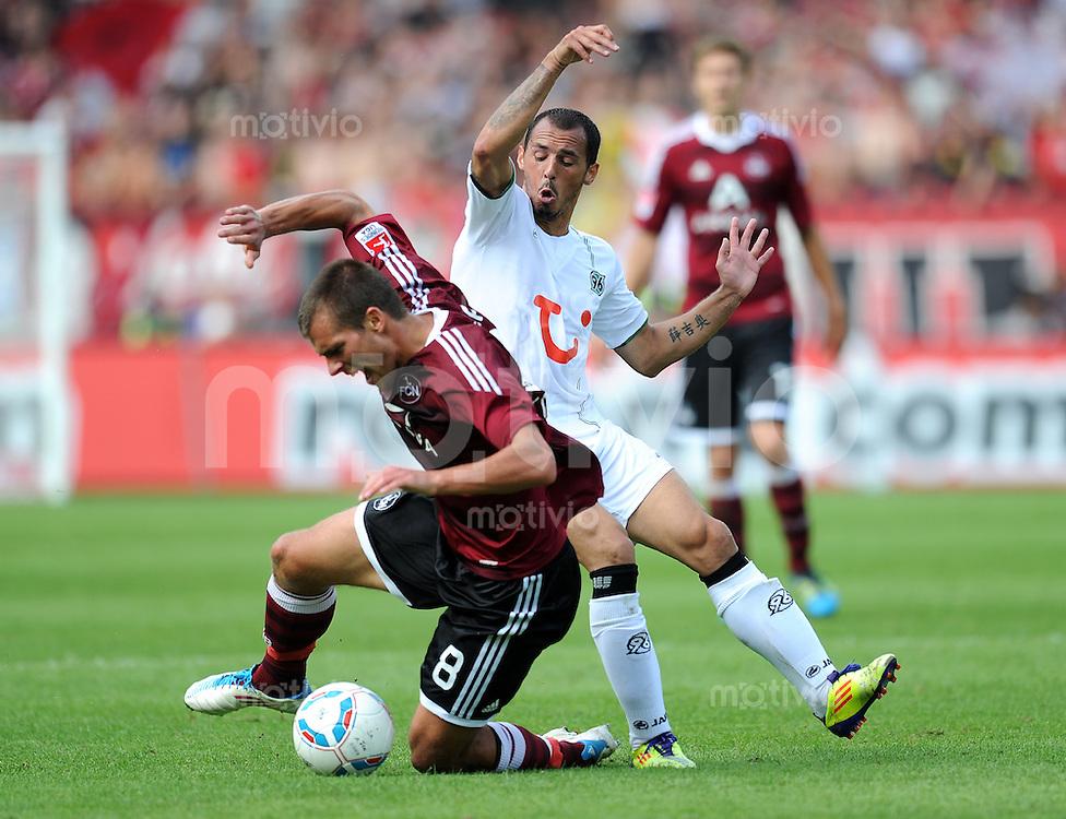 FUSSBALL   1. BUNDESLIGA  SAISON 2011/2012   2. Spieltag 1 FC Nuernberg - Hannover 96          13.08.2011 Christian Eigler (li, 1 FC Nuernberg) gegen Sergio Pinto (re, Hannover 96)
