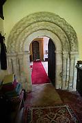 Village parish church of Saint Peter, Theberton, Suffolk, England, UK Norman arched doorway chevron moulding