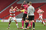 Nathan Tyson (14) of Doncaster Rovers remonstrates with Ricardo Santos (12) of Peterborough United during the Sky Bet League 1 match between Doncaster Rovers and Peterborough United at the Keepmoat Stadium, Doncaster, England on 19 March 2016. Photo by Ian Lyall.