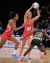 Englands Chelsea Pitman, centre, looks to pass the ball against England in the Netball Quad Series netball match, ILT Stadium Southland, Invercargill, New Zealand, Sept. 3 2017.  Credit:SNPA / Adam Binns ** NO ARCHIVING**