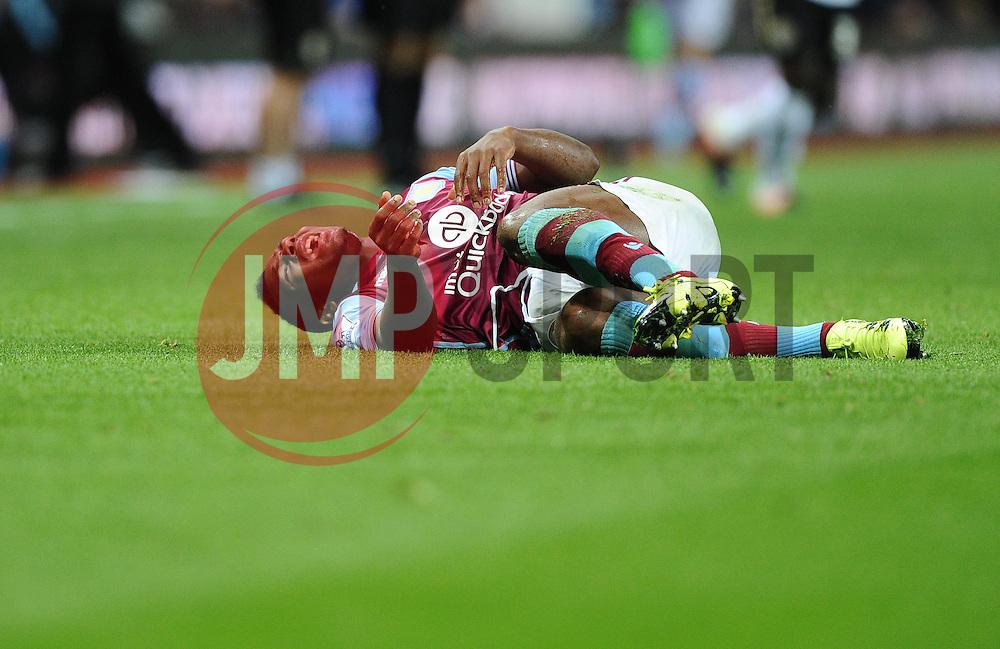 Adama Traore of Aston Villa goes down injured  - Mandatory byline: Joe Meredith/JMP - 07966386802 - 25/08/2015 - FOOTBALL - Villa Park -Birmingham,England - Aston Villa v Notts County - Capital One Cup - Second Round