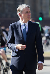 British Foreign Secretary Philip Hammond is spotted in Westminster as he crosses from Parliament Square to Whitehall.
