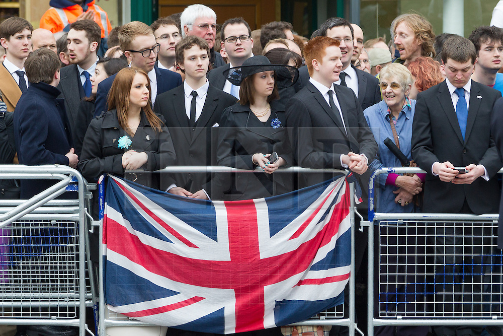 © Licensed to London News Pictures . 17/04/2013 . London , UK . Mourners with an upside dawn Union flag at Ludgate Circus . The funeral of former British Conservative Prime Minister , Baroness Margaret Thatcher , today (Wednesday 17th April 2013) in Central London . Baroness Thatcher died from a stroke at the age of 87 . Photo credit : Joel Goodman/LNP