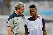 England manager Roy Hodgson (L) speaks to Raheem Sterling of England (R) during the England training session the day before their final Group D match against Costa Rica at Mineirão, Belo Horizonte, Brazil. <br /> Picture by Andrew Tobin/Focus Images Ltd +44 7710 761829<br /> 23/06/2014