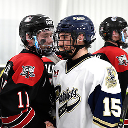 TORONTO, ON  - APR 10,  2018: Ontario Junior Hockey League, South West Conference Championship Series. Game seven of the best of seven series between Georgetown Raiders and the Toronto Patriots. Bailey Molella #11 of the Georgetown Raiders and Dante Spagnuolo #15 of the Toronto Patriots after the final buzzer of the South West Conference. <br /> (Photo by Andy Corneau / OJHL Images)
