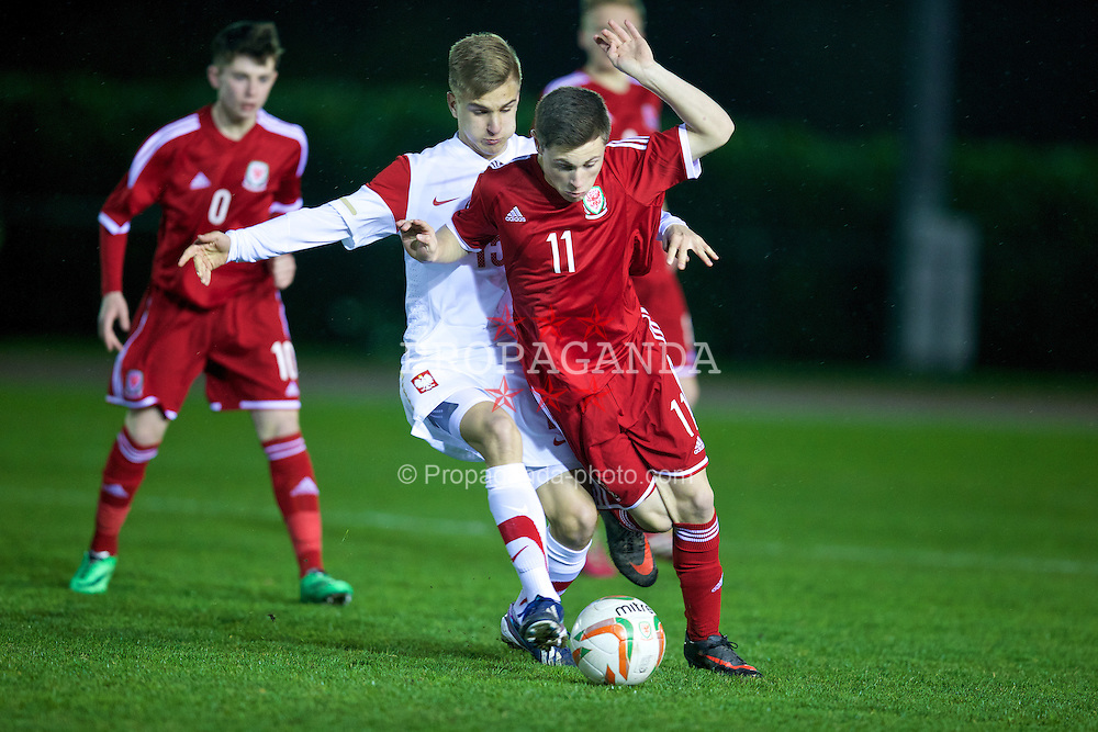 CONNAH'S QUAY, WALES - Thursday, March 20, 2014: Wales' Kieran Evans in action against Poland's Marek Mroz during the Under-15's International Friendly match at the Deeside Stadium. (Pic by David Rawcliffe/Propaganda)