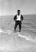 posing with feet in the water on a trip to the sea 1950s