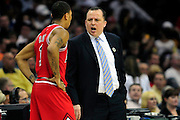 April 8, 2011; Cleveland, OH, USA; Chicago Bulls head coach Tom Thibodeau yells at Chicago Bulls point guard Derrick Rose (1) during the fourth quarter against the Cleveland Cavaliers at Quicken Loans Arena. The Bulls beat the Cavaliers 93-82. Mandatory Credit: Jason Miller-US PRESSWIRE