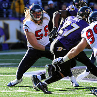 15 January 2012: Houston Texans outside linebacker Brooks Reed (58) in action against Baltimore Ravens running back Ray Rice (27) in the Divisional Playoff at M&T Bank Stadium in Baltimore, MD. The Ravens defeated the Texans 20-13 to advance to the AFC Championship game..