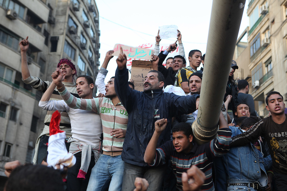 Protesters on top of an Egyptian army tank at Tahrir Square on 29 January call for the ouster of President Hosni Mubarak.