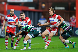 Gloucester Winger (#11) Shane Monahan is tackled by London Irish Winger (#11) Anthony Watson during the first half of the match - Photo mandatory by-line: Rogan Thomson/JMP - Tel: Mobile: 07966 386802 15/12/2012 - SPORT - RUGBY - Kingsholm Stadium - Gloucester. Gloucester Rugby v London Irish - Amlin Challenge Cup Round 4.