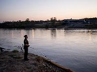 A border patrol agent stands along the Rio Grande river, in Roma, TX, on the U.S,-Mexico border on February 1, 2017 (Photo/Scott Dalton)