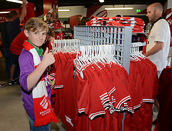 A young Bristol City fan puts his thumb up as he searches for a shirt at the new club shop - Mandatory byline: Dougie Allward/JMP - 07966386802 - 15/08/2015 - FOOTBALL - Ashton Gate -Bristol,England - Bristol City v Brentford - Sky Bet Championship