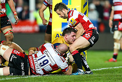 James Phillips of Bristol Rugby is held up by Greig Laidlaw and Joe Latta of Gloucester Rugby - Rogan Thomson/JMP - 03/12/2016 - RUGBY UNION - Kingsholm Stadium - Gloucester, England - Gloucester Rugby v Bristol Rugby - Aviva Premiership.
