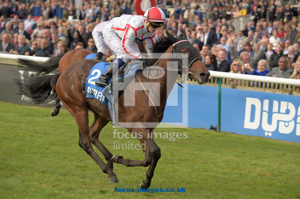 Scarlet Dragon ridden by Hollie Doyle (white with red seams) wins Godolphin Flying start Old Rowley Cup on the Friday of the Dubai Future Champions Festival on the Rowley Mile Course at Newmarket, Suffolk<br /> Picture by Martin Lynch/Focus Images Ltd 07501333150<br /> 07/10/2016