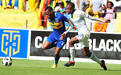 Cape Town--180401  Cape Town City midfielder Surprise Ralani  challenged by Thapelo Morena of Mamelodi Sundowns  during the Nedbank Cup quarter final game at the Cape Town Stadium.Sundowns won the game 2-1 and will play maritzburg in the Semi-final  .Photographer;Phando Jikelo/African News Agency/ANA