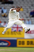 Andre Adams leaps in the air after dismissing James Foster during the 3rd cricket test between England and New Zealand, 3 April, 2002, Eden Park, Auckland, New Zealand. Photo: Andrew Cornaga/PHOTOSPORT<br />
