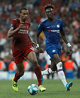 ISTANBUL, TURKEY - AUGUST 14: Joel Matip (L) of Liverpool and Tammy Abraham of Chelsea vie for the ball during the UEFA Super Cup match between Liverpool and Chelsea at Vodafone Park on August 14, 2019 in Istanbul, Turkey. (Photo by MB Media/Getty Images)