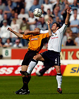 Photo. Jed Wee, Digitalsport<br /> NORWAY ONLY<br /> <br /> Wolverhampton Wanderers v Tottenham Hotspurs, FA Barclaycard Premiership, 15/05/2004.<br /> Spurs' Michael Brown (R) tries to stop Wolves' Alex Rae