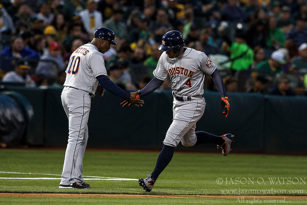 OAKLAND, CA - JULY 19:  George Springer #4 of the Houston Astros is congratulated by third base coach Gary Pettis #10 after hitting a home run against the Oakland Athletics during the fifth inning at the Oakland Coliseum on July 19, 2016 in Oakland, California. The Oakland Athletics defeated the Houston Astros 4-3 in 10 innings.  (Photo by Jason O. Watson/Getty Images) *** Local Caption *** George Springer; Gary Pettis
