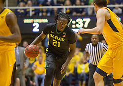Feb 6, 2016; Morgantown, WV, USA; Baylor Bears forward Taurean Prince (21) dribbles the ball during the first half against the West Virginia Mountaineers at the WVU Coliseum. Mandatory Credit: Ben Queen-USA TODAY Sports