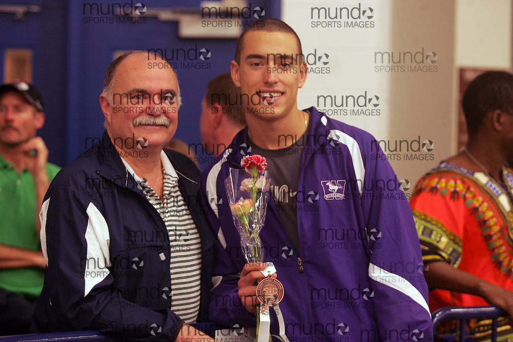 (Windsor, Ontario---12 March 2010) .Western's Matt Brisson and his dad at the 2010 Canadian Interuniversity Sport Track and Field Championships at the St. Denis Center. Photograph copyright Geoff Robins/Mundo Sport Images. www.mundosportimages.com