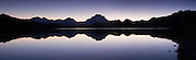 Panorama of dusk at oxbow bend in Grand Teton National Park.