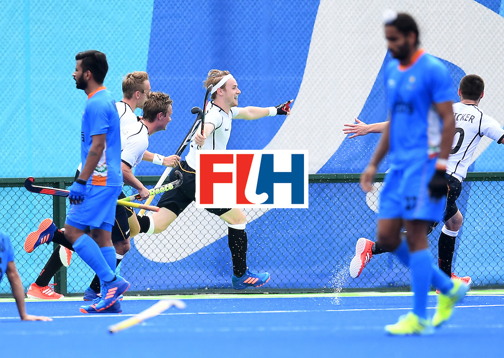 Germany's Christopher Ruhr (C) celebrates scoring a goal during the men's field hockey Germany vs India match of the Rio 2016 Olympics Games at the Olympic Hockey Centre in Rio de Janeiro on August, 8 2016. / AFP / MANAN VATSYAYANA        (Photo credit should read MANAN VATSYAYANA/AFP/Getty Images)