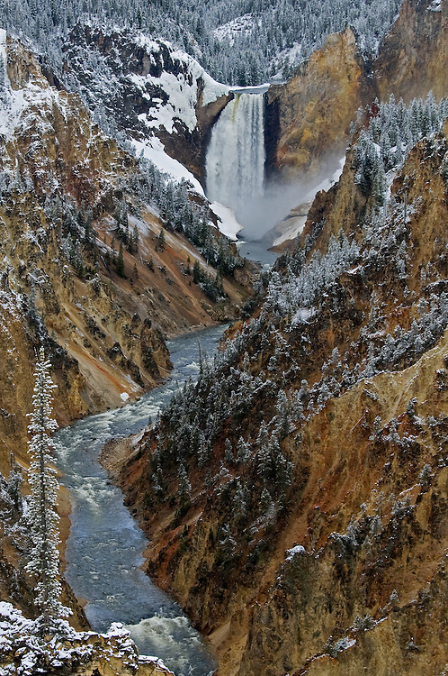 The Lower Falls, as seen from Artist Point, tumbles over 300 feet into the Grand Canyon of the Yellowstone. This view was made famous in a painting by Thomas Moran as seen during his travels through the area as part of the Hayden Expedition in the late 1800s.