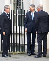 Downing Street, London, January 24th 2017. British Chancellor Philip Hammond welcomes Australian Treasurer Scott Morrison MP and The Australian High Commissioner Alexander Downer to no 11 Downing Street.