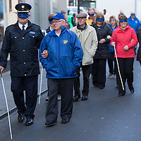 Chief Supt of the Clare Garda Division John Kerins  helped by Sean Murphy of Seeking Vision Clare walk a mile for the blind