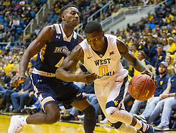 Nov 11, 2016; Morgantown, WV, USA; West Virginia Mountaineers guard Teyvon Myers (0) drives baseline past Mount St. Mary's Mountaineers guard Khalid Nwandu (4) during the second half at WVU Coliseum. Mandatory Credit: Ben Queen-USA TODAY Sports