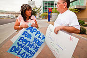 06 APRIL 2011 - PHOENIX, AZ: Rosie Dear (CQ) a Social Security employee, talks to Dan Pollard (CQ) from Peoria, about getting a Social Security card for a member of his family while they picket at the Social Security offices on N 7th Ave in Phoenix Wednesday. A handful of people attended the picket, which was organized by Strengthen Social Security, Alliance for Retired Americans and AFGE (American Federation of Government Employees). The picket was held to draw attention to the importance of Social Security in advance of an expected government shutdown later this week. Similar events were held across the country.    PHOTO BY JACK KURTZ