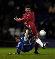 Photo: Jed Wee.<br />Oldham Athletic v Chasetown. The FA Cup. 16/11/2005.<br /><br />Chasetown's Steve Edwards (R) is tackled by Oldham's Paul Edwards.
