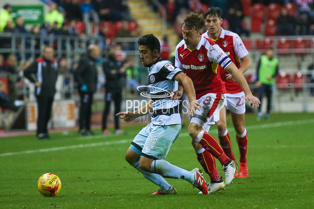 Queens Park Rangers  midfielder Massimo Luongo (21)  is tackled by Rotherham United midfielder Lee Frecklington (8)  during the EFL Sky Bet Championship match between Rotherham United and Queens Park Rangers at the New York Stadium, Rotherham, England on 10 December 2016. Photo by Simon Davies.