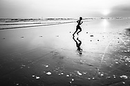 Burmese man runs on a beach of Sittwe, Rakhine State, Myanmar, Asia