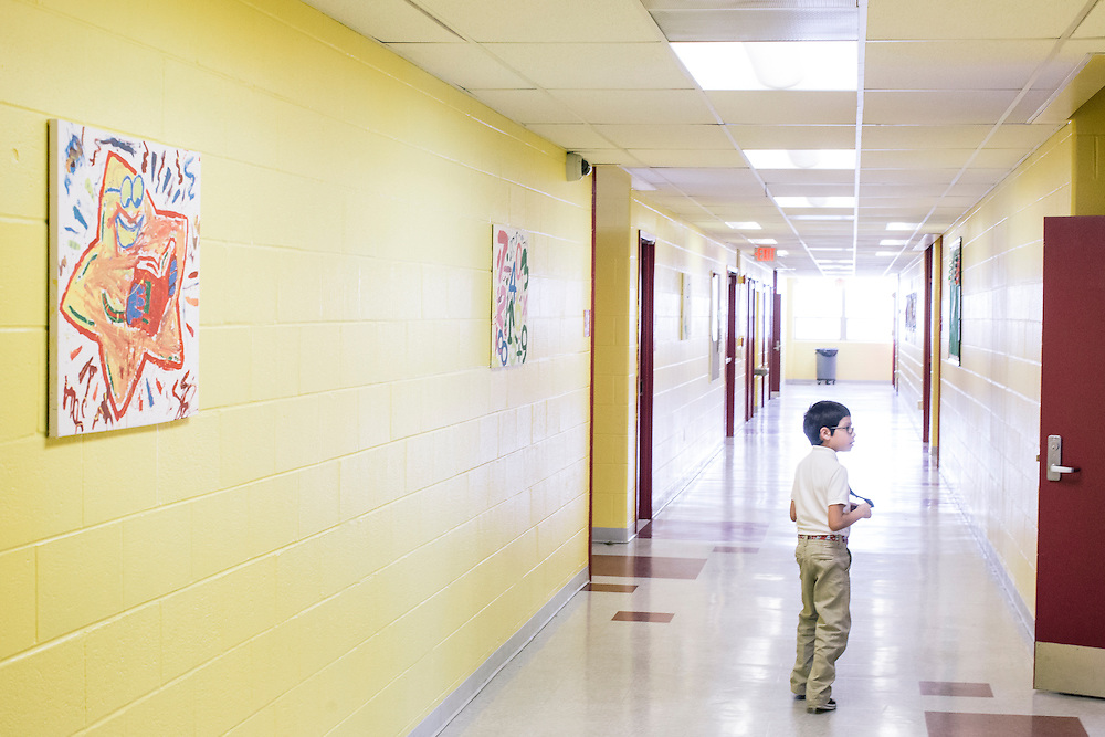 Eric Sanchez, 7, whose  father is in the Army stationed at Joint Base Anacostia-Bolling in SW Washington, D.C., walks down the hall after class at Leckie Elementary School. Nearly a third of the school is attended by the children of military families.