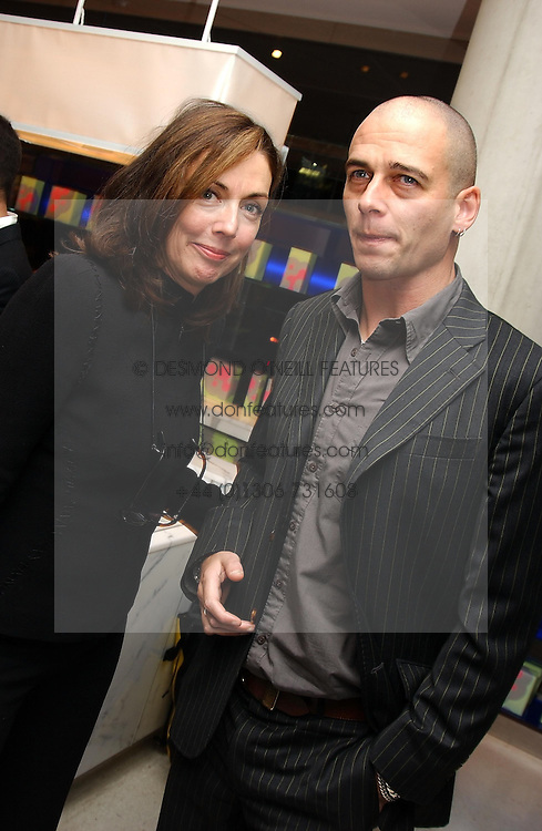 JUDITH GREER and DINOS CHAPMAN at a dinner hosted by Cartier to celebrate the opening of the 2004 Frieze Art Fair, held at Yauacha 15-17 Broadwick Street, London W1 on 13th October 2004.<br />